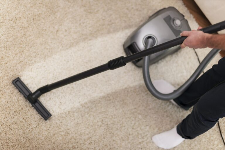 Close up of vacuuming a carpet